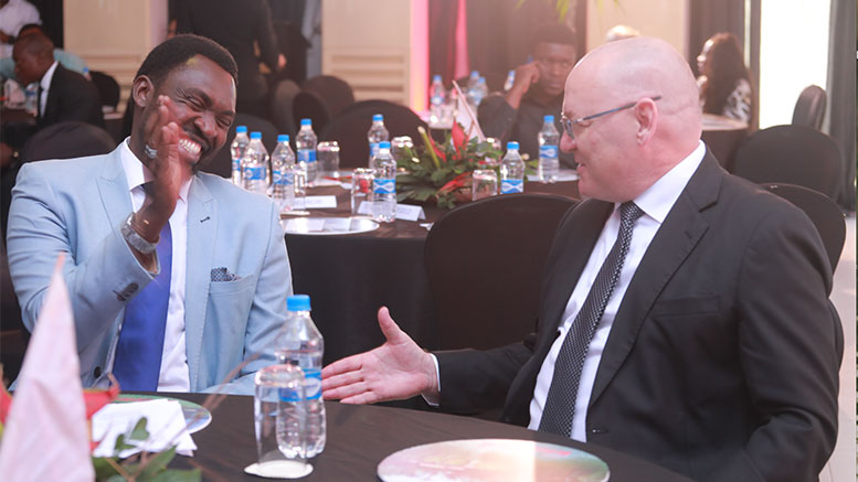 Tanzania Minister of Tourism Dr. Hamisi Kigwangalla with Stanbic Bank's Chief Executive, Ken Cockerill