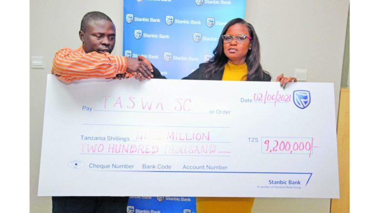 Stanbic Bank Tanzania Desideria Mwegelo with Taswa Chairman