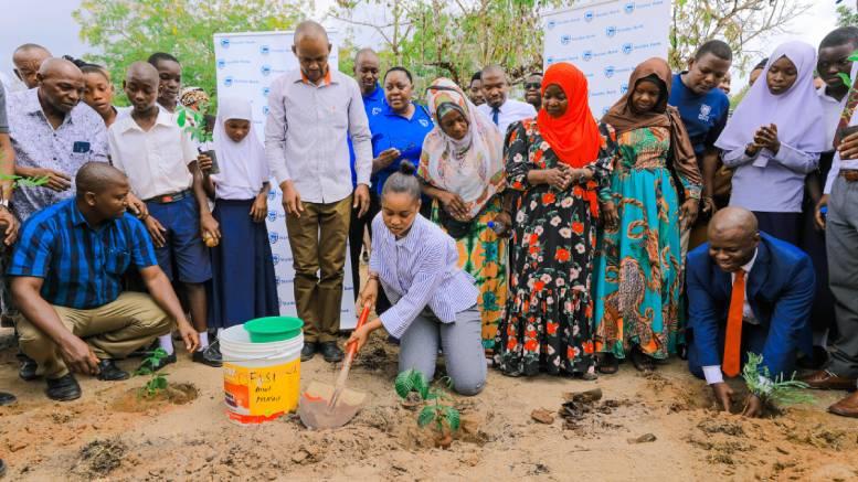 Stanbic Bank Tanzania plant tree Tuangoma Primary School Omari Mtiga